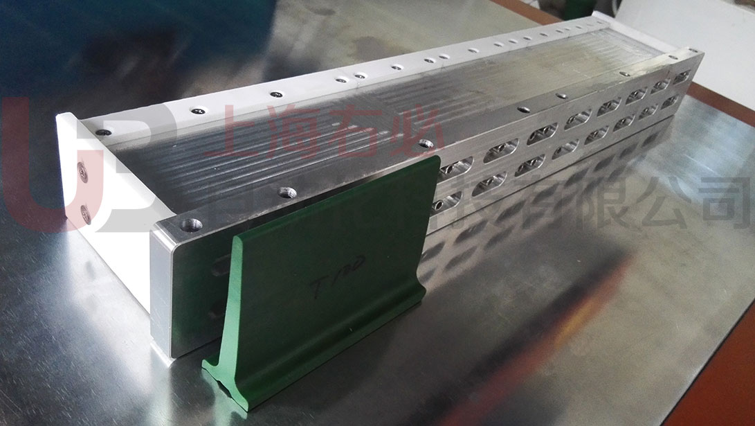 assembling electrodes for conveyor belt T-cleats